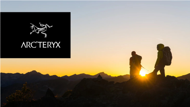 Arteryx Logo with hikers in the background