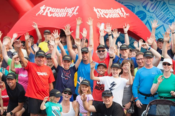 People Cheering for the Running Room at an event